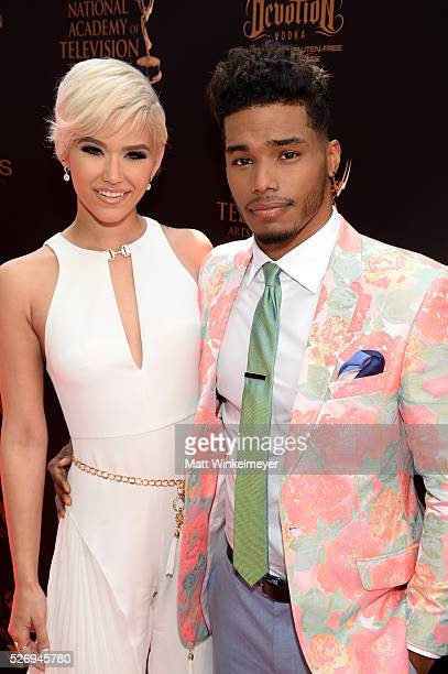 Actor Rome Flynn and model Camia Marie walk the red carpet at the 43rd Annual Daytime Emmy Awards at the Westin Bonaventure Hotel on May 1 2016 in...