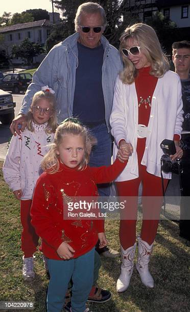 Actor Ron Ely and family attend Second Annual Toys for Tots Benefit on December 19 1992 at Hancock Park in Los Angeles California