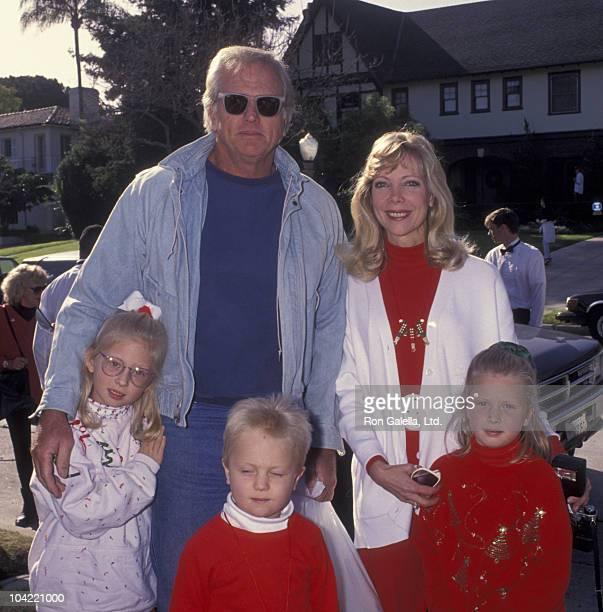 Actor Ron Ely and family including Valerie Ely attend Second Annual Toys for Tots Benefit on December 19 1992 at Hancock Park in Los Angeles...