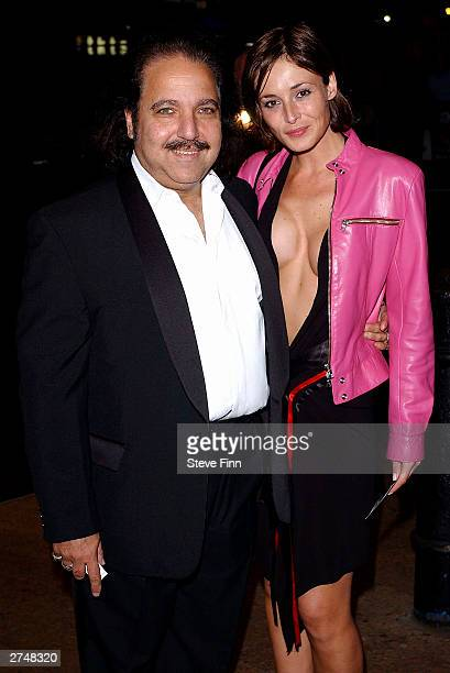 Actor Ron Jeremy with a lady friend arrive for the Gumball 3000 The Movie World Premiere held on November 20 2003 at the Odeon Leicester Square in...