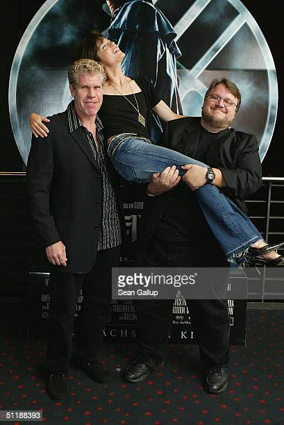 Actor Ron Perlman actress Selma Blair and director Guillermo del Toro attend a photocall to the German Premiere of Hellboy at the CinemaxX on August...