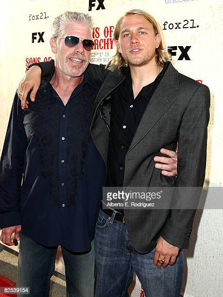 Actor Ron Perlman and actor Charlie Hunnam arrive at the series premiere screening of FX Network's Sons of Anarchy held at the Paramount Studios...