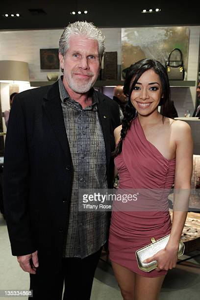 Actor Ron Perlman and actress Aimee Garcia attend the Opal Stone Luxury Handbags And Fine Jewelry Launch at Gray Gallery on December 8 2011 in...