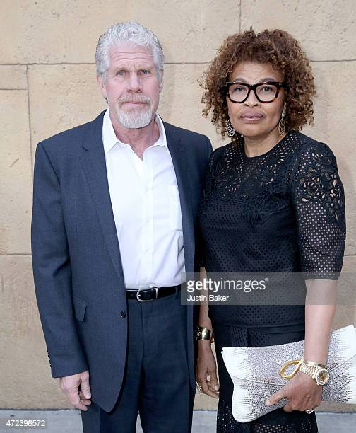 Actor Ron Perlman and Opal Stone Perlman attend Skin Trade Los Angeles Premiere at the Egyptian Theatre on May 6 2015 in Hollywood California