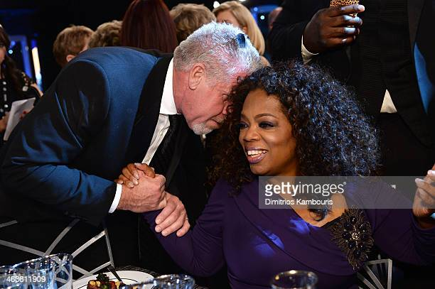 Actor Ron Perlman and Oprah Winfrey attend the 20th Annual Screen Actors Guild Awards at The Shrine Auditorium on January 18 2014 in Los Angeles...