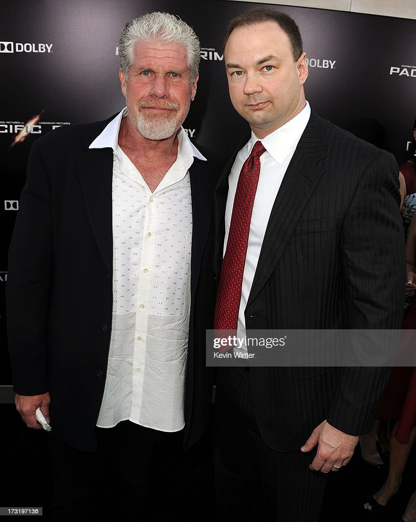 Actor Ron Perlman (L) and producer Thomas Tull arrive at the premiere of Warner Bros. Pictures' and Legendary Pictures' 'Pacific Rim' at Dolby Theatre on July 9, 2013 in Hollywood, California.