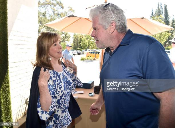 Actor Ron Perlman and SAGAFTRA Foundation Executive Director Cyd Wilson attend the SAGAFTRA Foundation 8th Annual LA Golf Classic Fundraiser at...