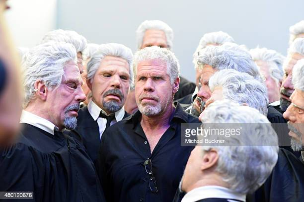 "Actor Ron Perlman of ""Hand of God"" poses with Ron Perlman impersonators at The Getty Images Portrait Studio powered by Samsung Galaxy At ComicCon..."