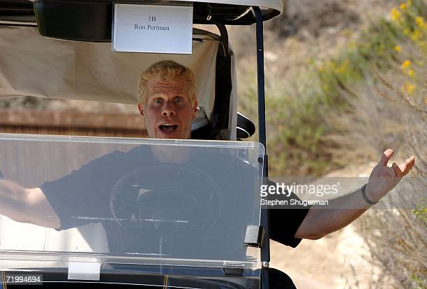 Actor Ron Perlman smiles in the cart at the 9th annual American Film Institute Golf Classic at he Trump National Golf Club September 25, 2006 in...