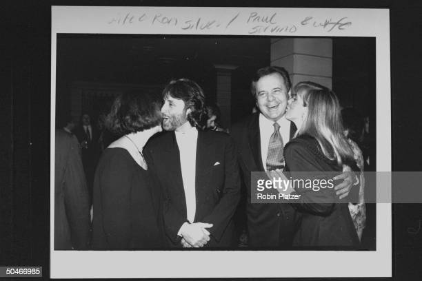 Actor Ron Silver nuzzling his wife Lynne as actor Paul Sorvino gets a kiss on the cheek from his wife at premiere of the newly restored version of...