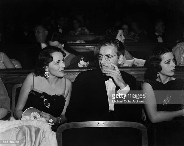 Actor Ronald Colman his wife Benita Hume and actress Hedy Lamarr attend the opera in Los Angeles California