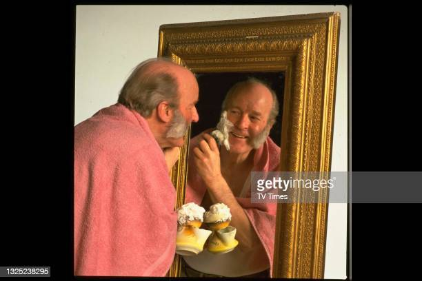 Actor Ronald Magill photographed shaving while in character as Amos Brearly in television soap Emmerdale, circa 1991.
