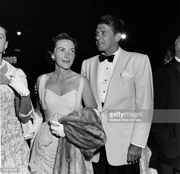 Actor Ronald Reagan and his wife actress Nancy Reagan attend the premiere of King and I in Los AngelesCA