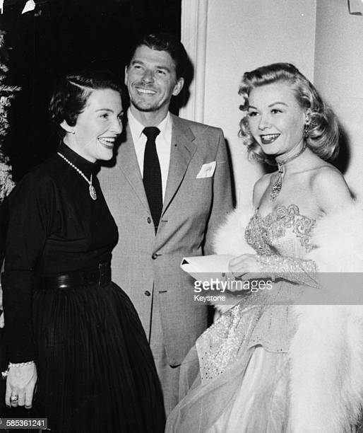 Actor Ronald Reagan and his wife Nancy talking to actress and dancer Vera Ellen at a party in Hollywood CA circa 1955