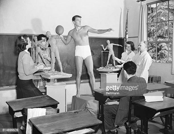 Actor Ronald Reagan poses for a sculpture class at the University of Southern California in 1940 He was chosen as an example of the ideal male...