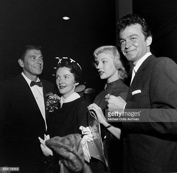 Actor Ronald Reagan with wife Nancy Reagan and friends attend the opening of the Ice Capades in Los AngelesCA