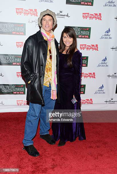 Actor Ronn Moss and actress Devin DeVasquez arrive at the 2012 Hollywood Christmas Parade Benefiting Marine Toys For Tots on November 25 2012 in...