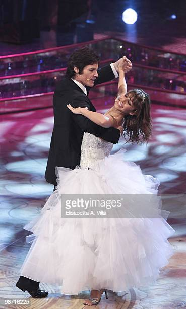 US actor Ronn Moss and his dance partner Sara Di Varia perform on the Italian TV show 'Ballando Con Le Stelle' at RAI Auditorium on January 9 2010 in...