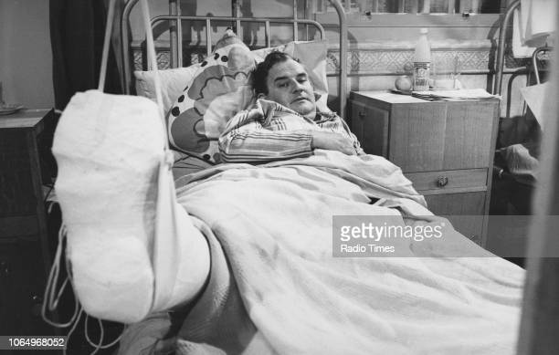 Actor Ronnie Barker lying in a hospital bed with a broken leg in a scene from episode 'Happy Release' of the television sitcom 'Porridge' June 8th...