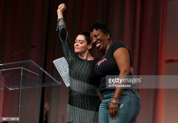 Actor Rose McGowan and Founder of #MeToo Campaign Tarana Burke embrace on stage at the Women's March / Women's Convention in Detroit Michigan on...