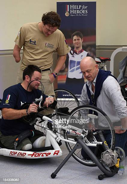 Actor Ross Kemp chats with amputee Steve Arnold and other wounded servicemen as they use some of the exercise machines in the new Help for Heroes'...