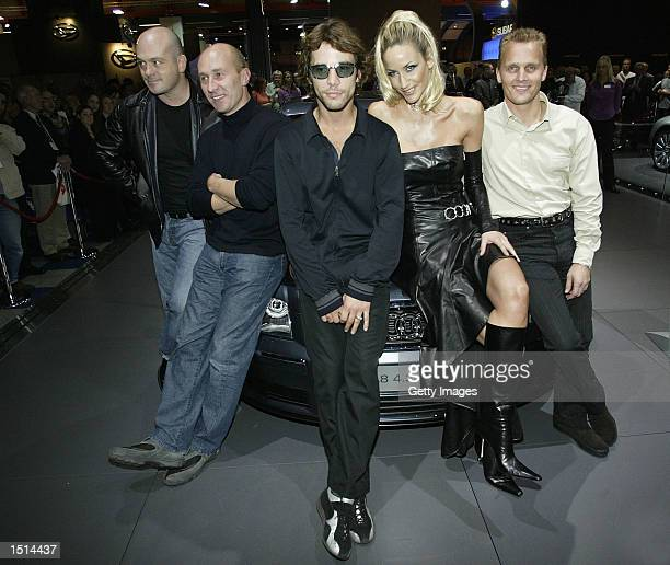 Actor Ross Kemp former Grand Prix driver Perry McCarty pop star Jay Kay Lisa Hutchins and former Grand Prix driver Johhny Herbert pose during the...