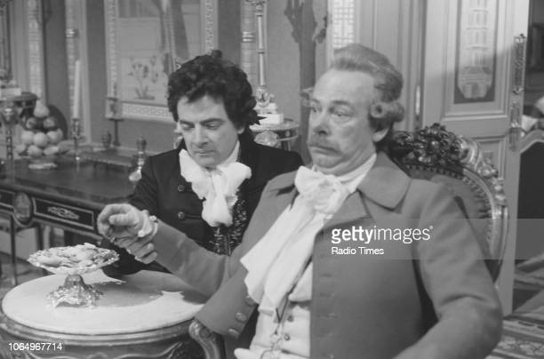 Actor Rowan Atkinson and Denis Lill in a scene from the television comedy special 'Blackadder's Christmas Carol' 1988