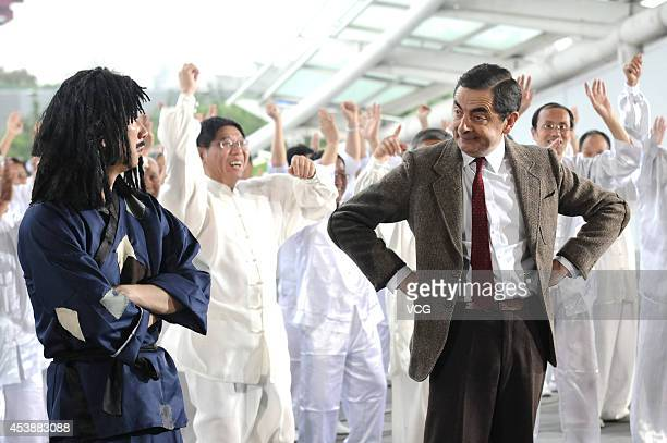 Actor Rowan Atkinson as Mr Bean performs square dance during a programme recording on August 21 2014 in Shanghai China