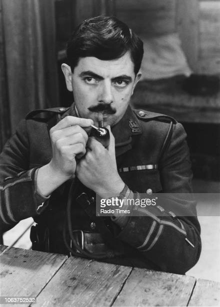 Actor Rowan Atkinson lighting a pipe in a scene from the television show 'Blackadder Goes Fourth' September 3rd 1989