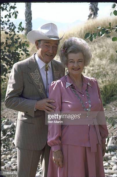 27423db4afd Actor Roy Rogers posing in dress cowboy outfit with his wife actress Dale  Evans in her
