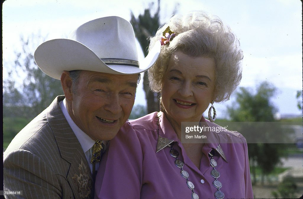 Actor Roy Rogers posing in dress cowboy outfit w his wife a : News Photo