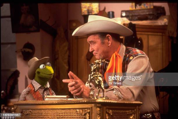Actor Roy Rogers with puppet character Kermit The Frog on the set of The Muppet Show at Elstree Studios, Hertfordshire, circa 1979.
