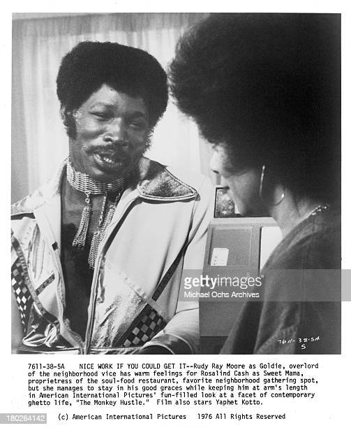 Actor Rudy Ray Moore and actress Rosalind Cash on set for the movie The Monkey Hu$tle in 1976