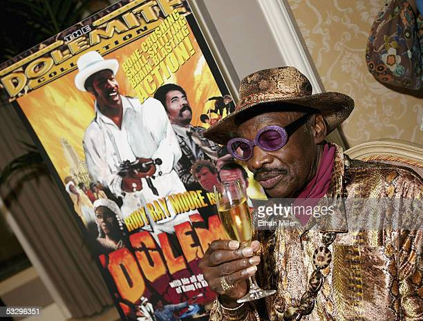 Actor Rudy Ray Moore creator and star of the classic Dolemite films poses at the Video Software Dealers Association's annual home video convention at...