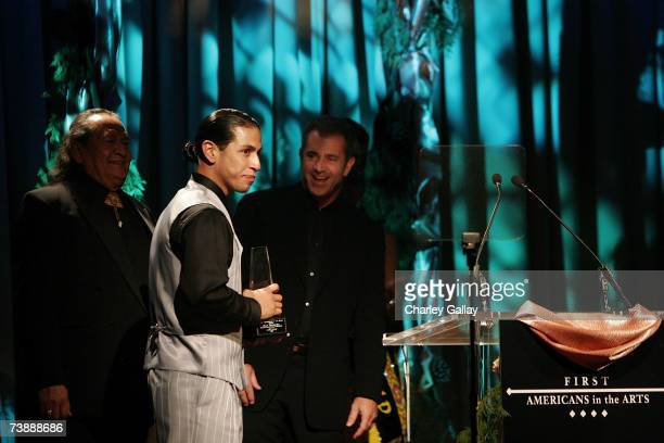 Actor Rudy Youngblood receives a Best Actor award from director Mel Gibson for his role in 'Apocalypto' at the 15th Annual First Americans in the...