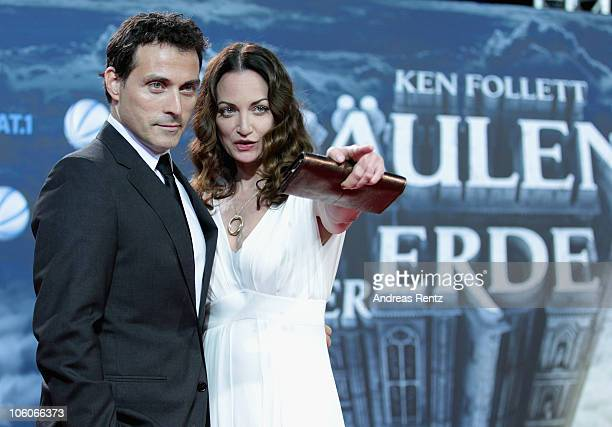 Actor Rufus Sewell and actress Natalia Woerner arrive for the 'The Pillars of the Earth' premiere at CineStar on October 26 2010 in Berlin Germany