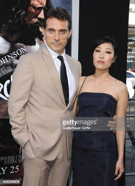 Actor Rufus Sewell and Ami Komai arrive at the Los Angeles Premiere of 'Hercules' at TCL Chinese Theatre on July 23 2014 in Hollywood California