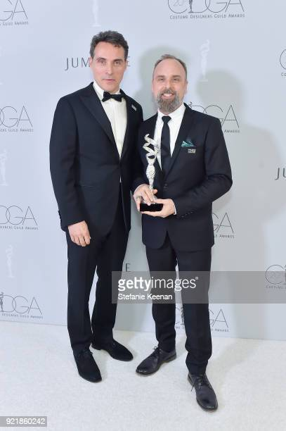 Actor Rufus Sewell and costume designer Luis Sequeira winner of the Excellence in Period Film award for 'The Shape of Water' attend the Costume...