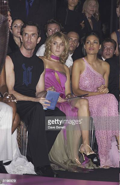 Actor Rupert Everett and Actress Chloe Sevigny with Actress Rosario Dawson in the audience at the Versace show at the Theatre National de Chaillot at...