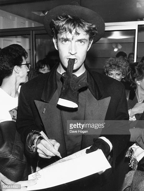 Actor Rupert Everett signing an autograph at a party in honor of musician Bob Dylan at the Astoria nightclub London October 9th 1987