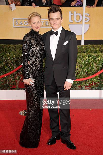 Actor Rupert Friend and Aimee Mullins arrive at the 20th Annual Screen Actors Guild Awards at The Shrine Auditorium on January 18 2014 in Los Angeles...