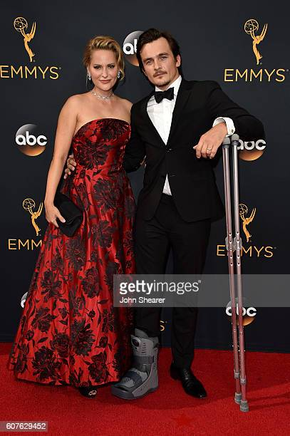 Actor Rupert Friend and Aimee Mullins arrive at the 68th Annual Primetime Emmy Awards at Microsoft Theater on September 18 2016 in Los Angeles...