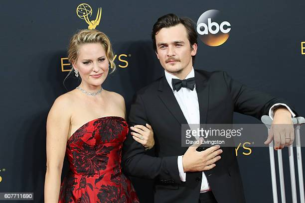 Actor Rupert Friend and Aimee Mullins arrive at the 68th Annual Primetime Emmy Awards at the Microsoft Theater on September 18 2016 in Los Angeles...
