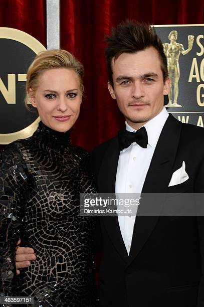 Actor Rupert Friend and Aimee Mullins attend 20th Annual Screen Actors Guild Awards at The Shrine Auditorium on January 18 2014 in Los Angeles...