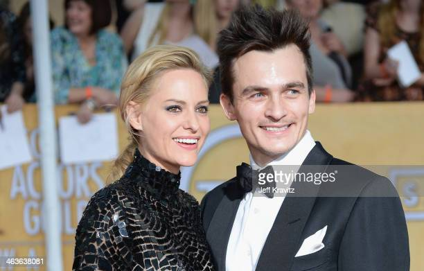 Actor Rupert Friend and Aimee Mullins attend the 20th Annual Screen Actors Guild Awards at The Shrine Auditorium on January 18 2014 in Los Angeles...