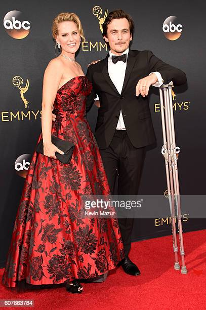 Actor Rupert Friend and Aimee Mullins attend the 68th Annual Primetime Emmy Awards at Microsoft Theater on September 18 2016 in Los Angeles California
