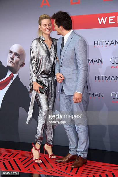 Actor Rupert Friend and Aimee Mullins attend the 'Hitman Agent 47' World premiere at CineStar on August 19 2015 in Berlin Germany