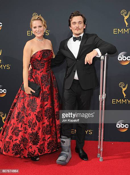 Actor Rupert Friend and wife Aimee Mullins arrive at the 68th Annual Primetime Emmy Awards at Microsoft Theater on September 18 2016 in Los Angeles...