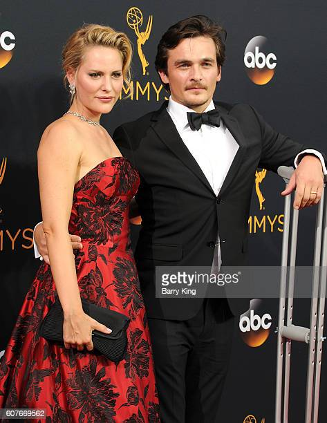 Actor Rupert Friend and wife Aimee Mullins attend the 68th Primetime Emmy Awards at Microsoft Theater on September 18 2016 in Los Angeles California
