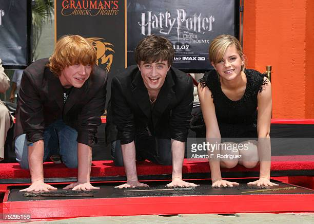 Actor Rupert Grint actor Daniel Radcliffe and actress Emma Watson attend the Harry Potter cast Hand Foot and WandPrint ceremony held at Grauman's...